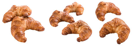 Fresh baked Croissants isolated on white. Some fresh baked Croissants isolated on white background Stock Photos