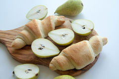 Fresh baked croissants with pears Royalty Free Stock Photos