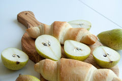 Fresh baked croissants with pears Stock Image