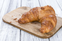 Fresh baked Croissants. Some fresh baked Croissants on rustic wooden background Stock Photo