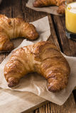 Fresh baked Croissants. Some fresh baked Croissants on rustic wooden background Stock Images