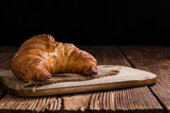 Fresh baked Croissants. Some fresh baked Croissants on rustic wooden background Royalty Free Stock Image