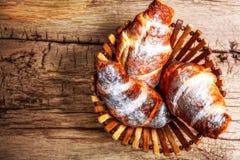Fresh baked croissants. On wooden background Stock Photo