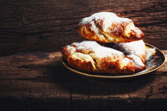 Fresh baked croissants. On wooden background Royalty Free Stock Image