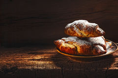 Fresh baked croissants. On wooden background Royalty Free Stock Photo