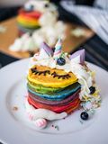 Fresh baked cute unicorn Rainbow Pancake with. kids meal. Fresh baked cute unicorn Rainbow Pancake with buttercream berry and decorate sugar. kids meal royalty free stock image