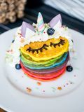Fresh baked cute unicorn Rainbow Pancake with. kids meal. Fresh baked cute unicorn Rainbow Pancake with buttercream berry and decorate sugar. kids meal stock images