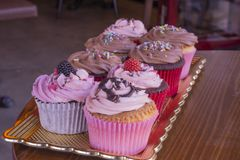 Fresh baked delicious different cupcakes served together stock images