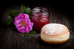 Fresh baked donut and red fruit jam Royalty Free Stock Image