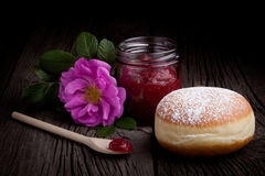 Fresh baked donut and red fruit jam Stock Photos