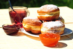 Fresh Baked Donuts With Fruit Jam And Tea Stock Photo