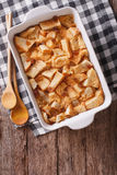 Fresh-baked English bread pudding in baking. vertical top view Stock Photo
