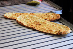Fresh baked flatbread. Freshly baked flatbread, hot out of the oven Royalty Free Stock Photo