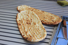 Fresh baked flatbread. Freshly baked flatbread, hot out of the oven Royalty Free Stock Images