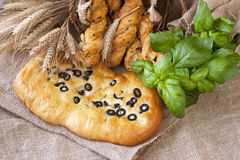 Fresh baked focaccia and small   loafs Royalty Free Stock Image