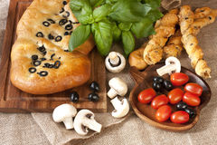 Fresh baked focaccia and small   loafs Royalty Free Stock Photo