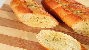 Fresh baked garlic bread with herbs stock footage