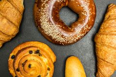 Fresh baked goods on a black background, fills the entire frame royalty free stock photo
