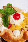 Fresh baked home made basket cake and maraschino cherry Royalty Free Stock Photo