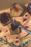 Fresh baked homemade healthy bread with blackcurrant jam - homemade marmalade with fresh organic fruits from garden. In rustic dec Stock Photos