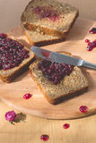 Fresh baked homemade healthy bread with blackcurrant jam - homemade marmalade with fresh organic fruits from garden. In rustic dec Stock Image