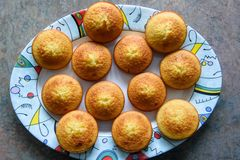Fresh baked homemade muffins on colorful plate. stock photo