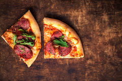 Fresh baked Hot pizza slice with cheese on a rustic wooden table. Closeup royalty free stock photos