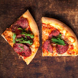Fresh baked Hot pizza slice with cheese on a rustic wooden table. Closeup with copy space for your design royalty free stock images