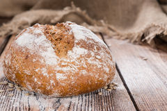 Fresh baked Loaf of Bread. On an old wooden table stock photography