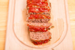 Fresh Baked Meatloaf Sliced on Wood Cutting Board Stock Photography