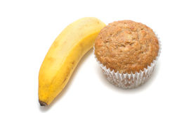 Fresh baked muffin and a banana Royalty Free Stock Image