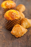 Fresh baked muffin and croissant mignon Royalty Free Stock Image
