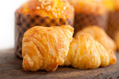 Fresh baked muffin and croissant mignon Stock Images