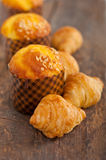 Fresh baked muffin and croissant mignon Royalty Free Stock Photo