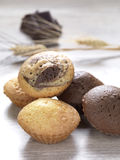 Fresh baked muffins. A variety of muffins on a wooden surface stock photo