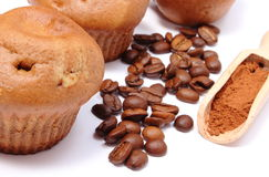 Fresh baked muffins, coffee grains and powdery cinnamon Stock Image