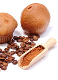 Fresh baked muffins, coffee grains and powdery cinnamon Stock Photography