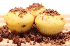 Fresh baked muffins and grated chocolate on wooden cutting board Royalty Free Stock Image