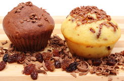 Fresh baked muffins and grated chocolate on wooden cutting board Stock Photo