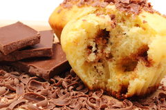 Fresh baked muffins, grated and portion of chocolate Royalty Free Stock Photography