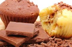 Fresh baked muffins, grated and portion of chocolate Royalty Free Stock Photos