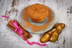 Fresh baked muffins with plums and powdery cinnamon, concept of delicious dessert Stock Photo