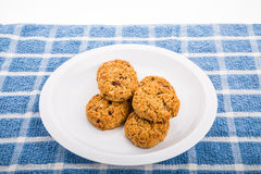 Fresh baked oatmeal cookies with raisins, cranberries and nuts Royalty Free Stock Photography
