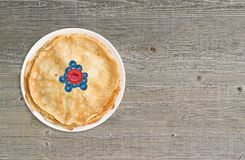 Fresh baked pancakes on white plate on wooden table grunge, retro style, close-up, top view, Stock Images