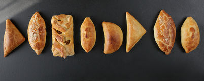 Fresh baked pasties filled with vegetables ,chicken,meat and cha Stock Images