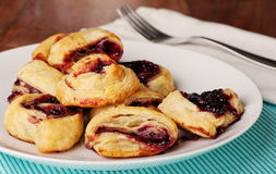 Fresh Baked Pastries With Boysenberry Jam. Pastries made with filo dough and jam, quick and easy for breakfast or dessert royalty free stock image