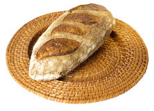 Fresh baked peasant batard on wicker tray Royalty Free Stock Images