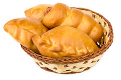 Fresh baked pies in wicker basket on white Royalty Free Stock Photo