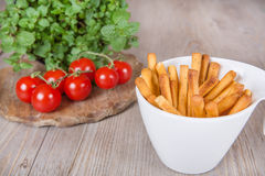 Fresh baked pizza bread sticks with bunch of tomato Royalty Free Stock Images