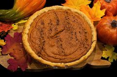 Fresh baked homemade pumpkin pie on cutting board. stock images